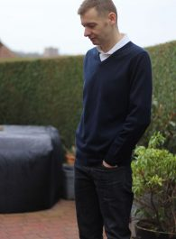 Cashmere Knit Styled With White Shirt And Dark Denim