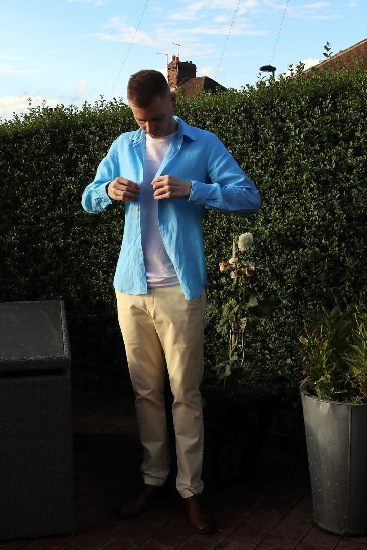 Wearing A Shirt Layered With A T-Shirt And Chinos