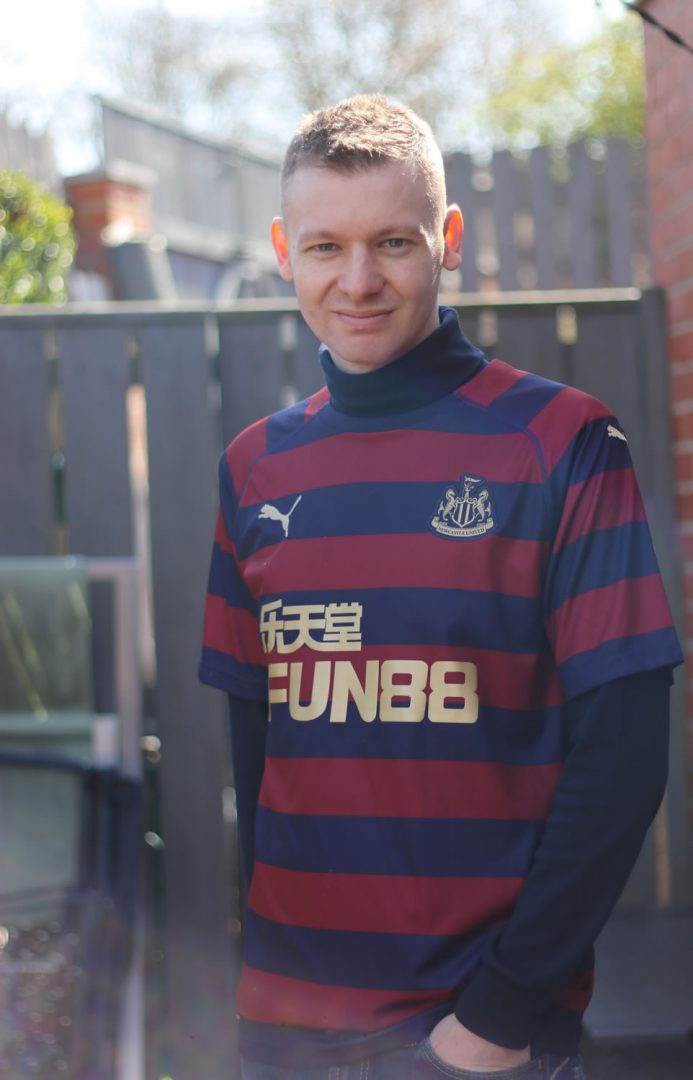 Roll Neck Layered With A Football Shirt
