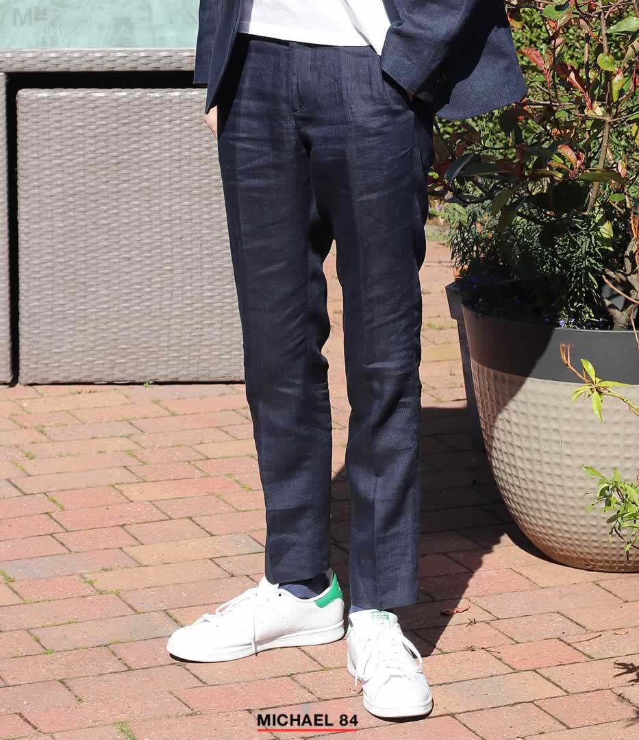 Navy suit with white trainers combination